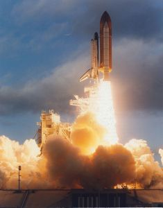 Space Shuttle Atlantis launches from pad 39A at the start of STS-74.