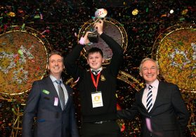 Shane Curran receiving his BTYSTE winners' trophy from Shay Walsh (MD BT Ireland) and Minister for Education and Skills, Richard Bruton. Photograph: BT Young Scientist